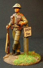 A Sgt from this famous Canadian Rifle Regiment. He wears the Mk1 helmet and is leaning on a German sign warning of mines!